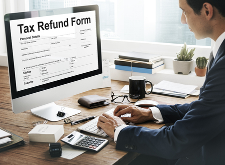 Man filling up tax refund form
