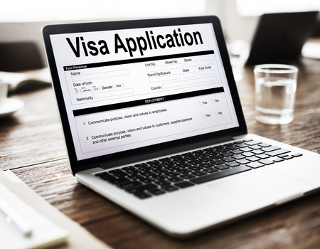 Visa application in a laptop Stock Photo
