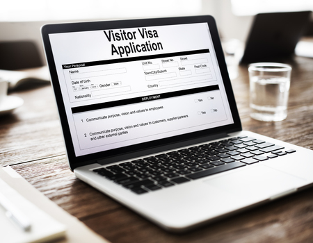 Visitor visa application in a laptop Stock Photo