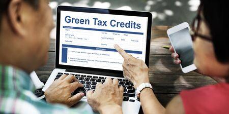 rebates: Green Tax Credits Document Form Concept Stock Photo