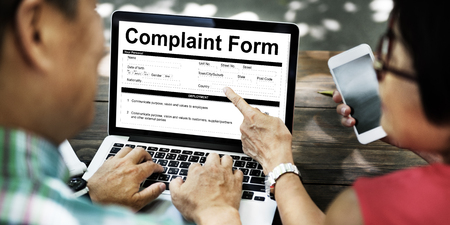 People checking their complaint form online