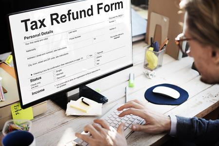 Man filling up a tax refund form