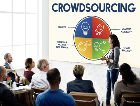 Woman presenting about crowd sourcing Stock Photo