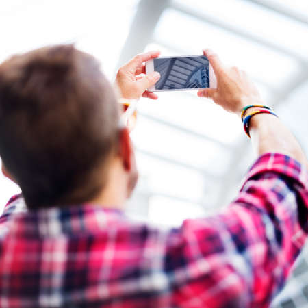 taking photo: Young Man Taking Photo Smartphone Concept