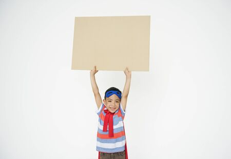 a placard: Superhero Kid Placard Copy Space Playful Concept