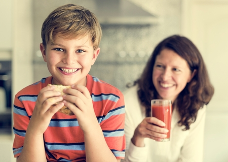 Mom and Son Eating Togetherness Cheerful Concept Stock Photo