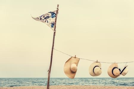 flag pole: Hanging Peg Woven Hats Flag Pole Sea Shore Concept