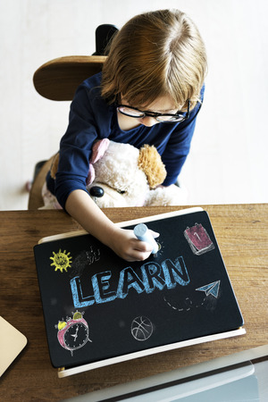 child of school age: Study Ideas Learn Kids Concept Stock Photo