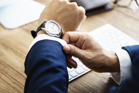 delay: Business Man Check Time Delay Concept Stock Photo
