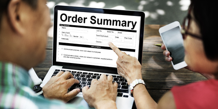 People using a laptop with order summary