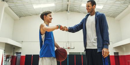 bounce: Coach Boy Athlete Basketball Bounce Sport Concept Stock Photo