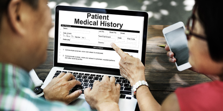 People using a laptop with patient medical history