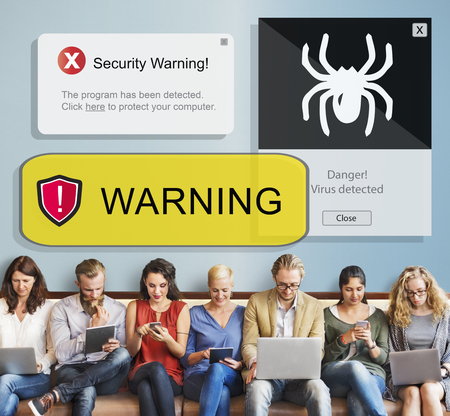 Group of people using digital devices with security warning concept Banco de Imagens