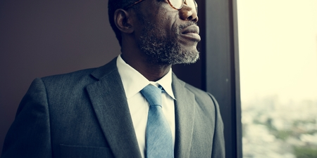 contemplation: African Descent Businessman Contemplation Concept