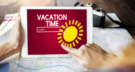 Woman using a digital tablet with vacation time concept