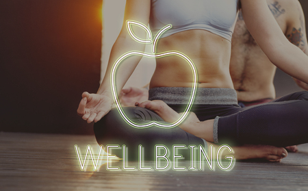 Woman doing yoga with wellbeing concept