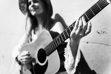 girl playing guitar: Blonde Girl Playing Guitar Concept