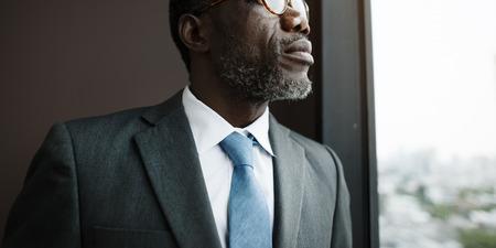 contemplation: African Descent Businessman Contemplation Concept