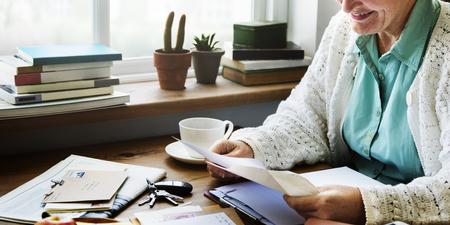 old letter: Senior Adult Reading Letter Concept Stock Photo