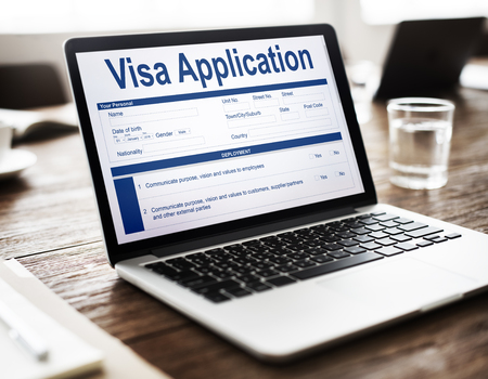 Laptop with visa application form Stock fotó