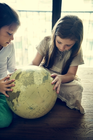 geography: Girls Learning Geography Lesson Concept