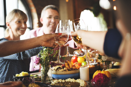 enjoyment: People Cheers Celebrating Thanksgiving Holiday Concept Stock Photo