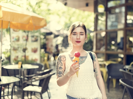 Woman Holding Icecream Outdoors Relaxation Casual Concept