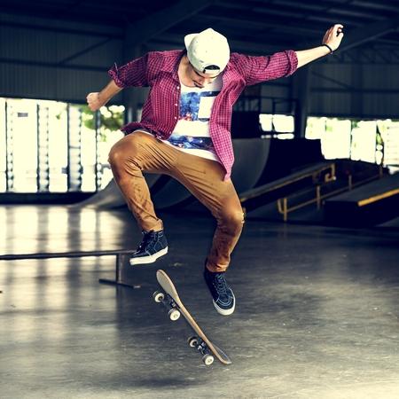 Boy Skateboarding Jump Lifestyle Hipster Concept