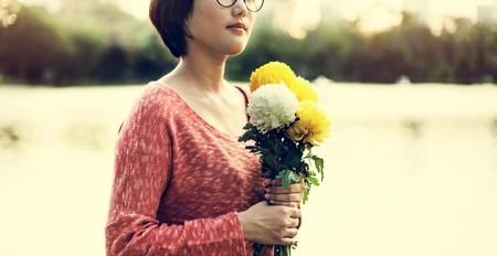 the freshness: Asian Girl Flower Freshness Relaxation Concept