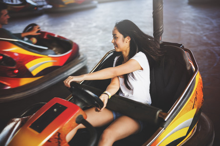 dashing: Girl Driving Bumper Car Happiness Enjoyment Concept