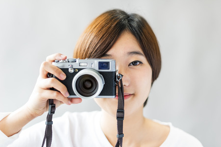 picture framing: Asian Girl Camera Photographer Focus Shooting Concept