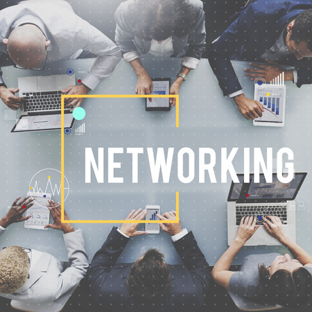 Business people using digital devices with networking concept 写真素材