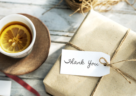 Present with thank you label