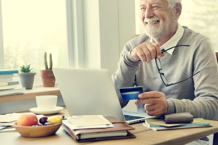 Senior Adult Holding Credit Card Concept Stock Photo