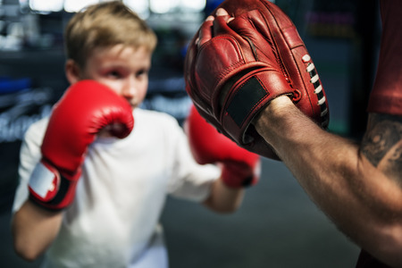 boy boxing: Boy Boxing Training Punch Mitts Exercise Concept Stock Photo