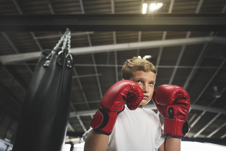 boy boxing: Boy Boxing Training Punching Bag Exercise Concept