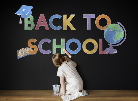 girl sitting down: Writing Sitting Board Chalk Education Concept Stock Photo