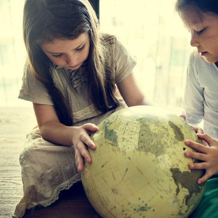 geography: Girls Friends Globe Geography Concept