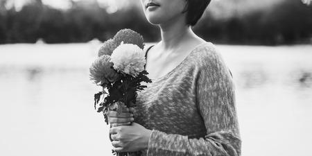 frescura: Asian Girl Flower Freshness Relaxation Concept