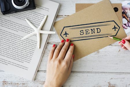 Woman writing a letter with send concept Stock Photo