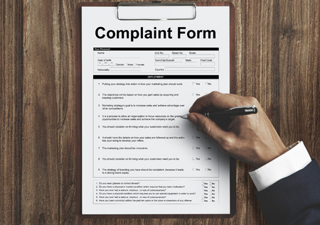 Businessman filling a complaint form