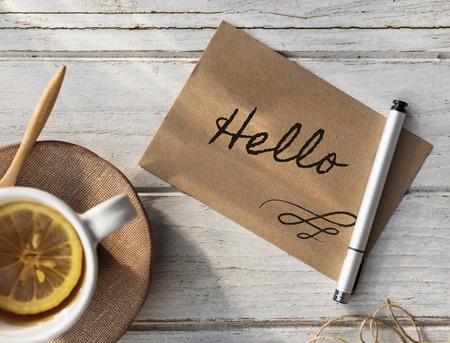 Hello writing on a card Фото со стока