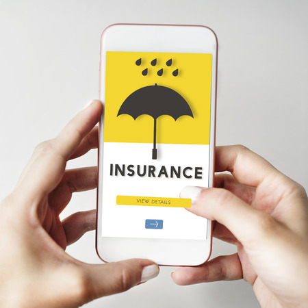 Person using a smartphone with insurance concept