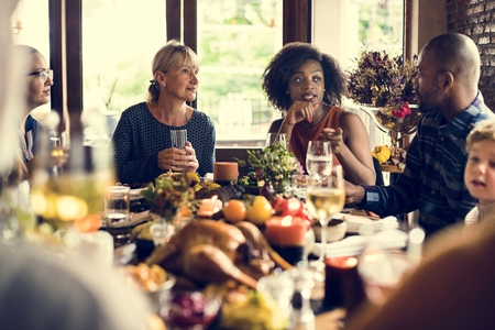 tradition: People Celebrating Thanksgiving Holiday Tradition Concept
