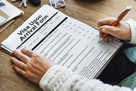 Woman filling visa upon arrival form Stock Photo