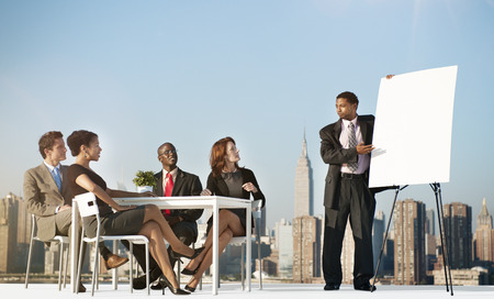 office presentation: Business Team Leader meeting Rooftop Concept Stock Photo