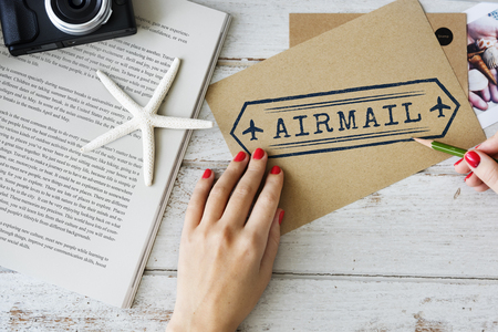 Woman holding a pencil with airmail concept