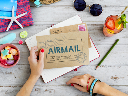 Woman holding an envelope with airmail concept Stock Photo