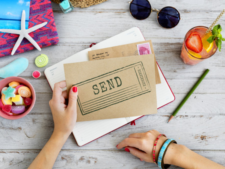 Woman holding an envelope with send concept