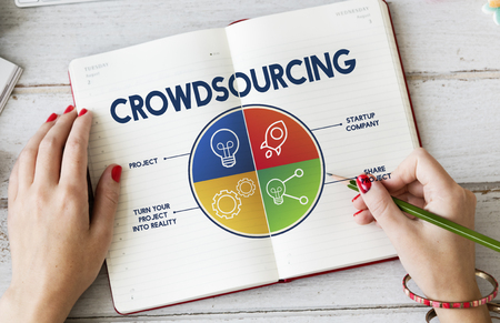 Woman writing on a book with crowdsourcing concept